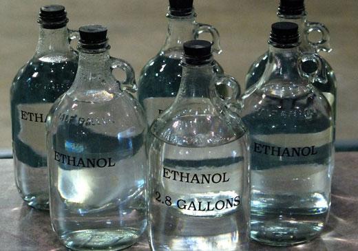 Спирт в больших бутылках